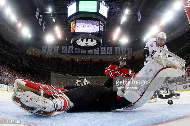 Anze Kopitar of the Los Angeles Kings shoots the game winning goal in overtime against Martin Brodeur of the New Jersey Devils during Game One of the...