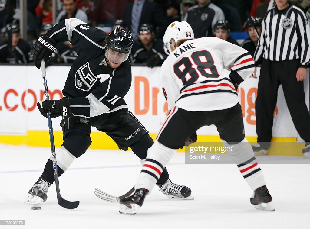 Anze Kopitar #11 of the Los Angeles Kings skates past Patrick Kane #88 of the Chicago Blackhawks during the second period of a game at Staples Center on November 28, 2015 in Los Angeles, California.