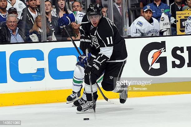 Anze Kopitar of the Los Angeles Kings skates with the puck against the Vancouver Canucks in Game Four of the Western Conference Quarterfinals during...