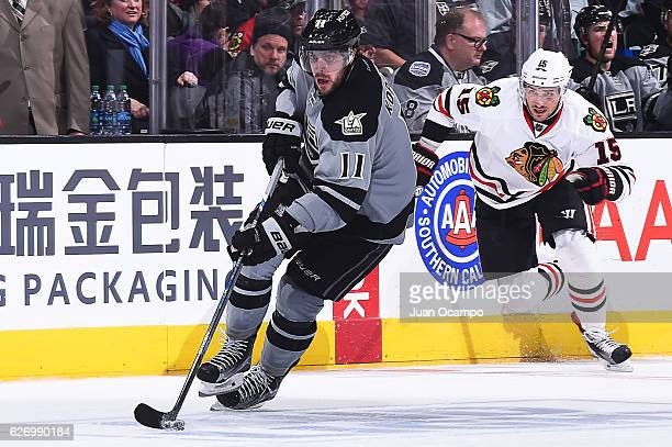 Anze Kopitar of the Los Angeles Kings skates with the puck against Artem Anisimov of the Chicago Blackhawks during the game on November 26 2016 at...