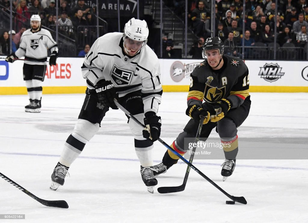 Anze Kopitar #11 of the Los Angeles Kings skates with the puck against Reilly Smith #19 of the Vegas Golden Knights in the first period of their game at T-Mobile Arena on February 27, 2018 in Las Vegas, Nevada. The Kings won 4-1.