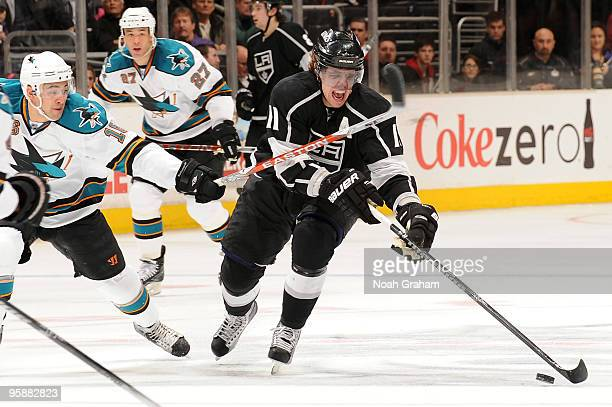 Anze Kopitar of the Los Angeles Kings skates with the puck against Devin Setoguchi of the San Jose Sharks on January 19 2010 at Staples Center in Los...