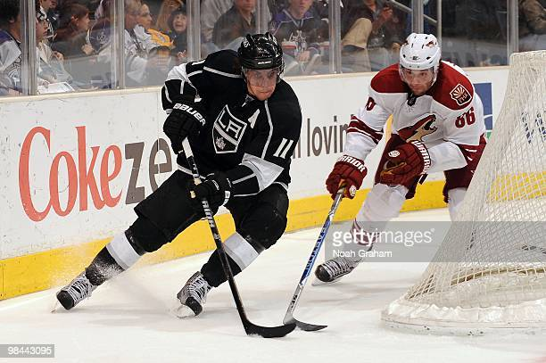 Anze Kopitar of the Los Angeles Kings skates with the puck against Wojtek Wolski of the Phoenix Coyotes on April 8 2010 at Staples Center in Los...