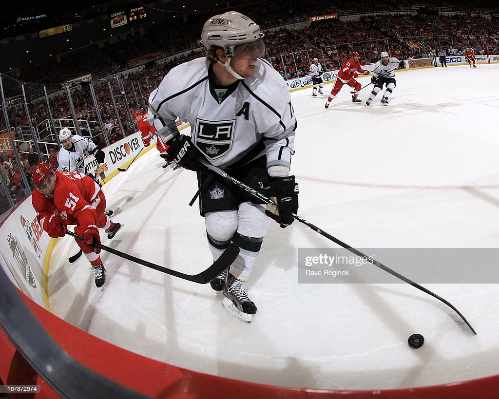 Anze Kopitar #11 of the Los Angeles Kings skates with the puck as Valtteri Filppula #51 of the Detroit Red Wings puts a stick on him during a NHL game at Joe Louis Arena on April 24, 2013 in Detroit, Michigan. Detroit defeated Los Angeles 3-1