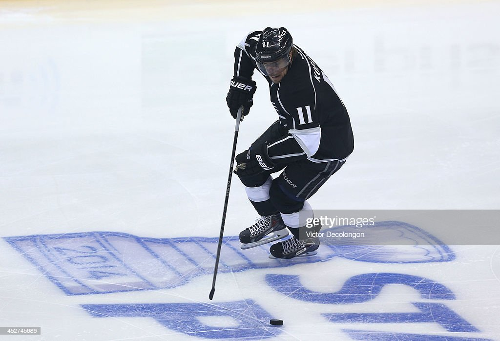 Anze Kopitar #11 of the Los Angeles Kings skates with the puck during Game Four of the First Round of the 2014 NHL Stanley Cup Playoffs against the San Jose Sharks at Staples Center on April 24, 2014 in Los Angeles, California. The Kings defeated the Sharks 6-3.
