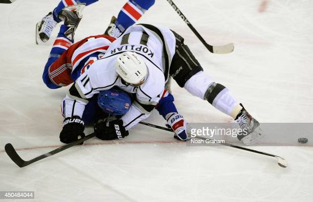 Anze Kopitar of the Los Angeles Kings takes down Marc Staal of the New York Rangers in the third period of Game Four of the 2014 Stanley Cup Final at...