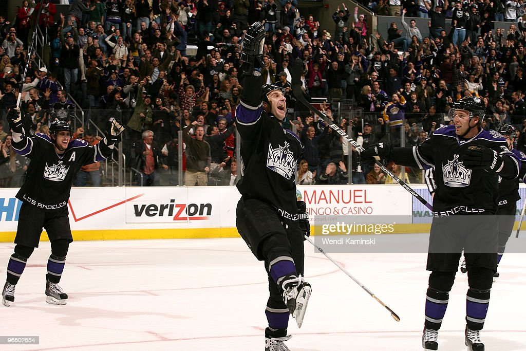 Anze Kopitar #11, Ryan Smyth #94, and Jack Johnson #3 of the Los Angeles Kings celebrate a goal during a game against the Edmonton Oilers on February 11, 2010 at Staples Center in Los Angeles, California.