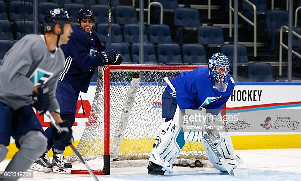 Anze Kopitar smiles while goalie Jaroslav Halak of Team Europe waits for a shot during a practice at the Centre Videotron on September 7, 2016 in...
