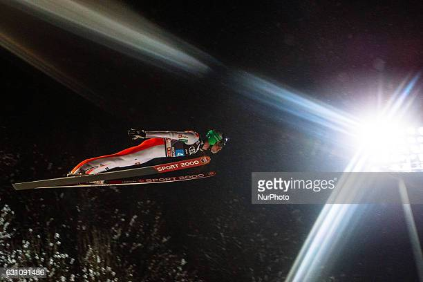 Anze Semenic of Slovenia soars through the air during his first competition jump on Day 2 on January 6 2017 in Bischofshofen Austria