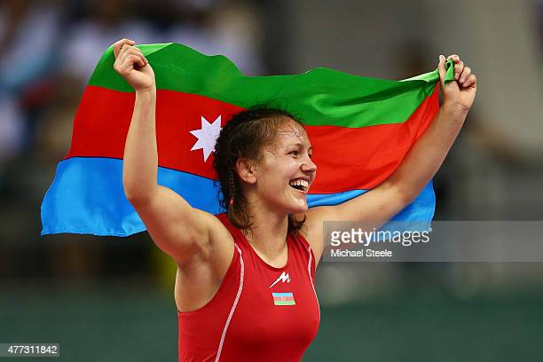 Anzhela Dorogan of Azerbaijan celebrates after winning gold in the Women's Wrestling 53kg Freestyle final against Roksana Zasina of Poland during day...