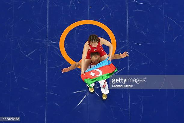 Anzhela Dorogan of Azerbaijan celebrates with her coach after winning gold in the Women's 53kg Wrestling during day four of the Baku 2015 European...