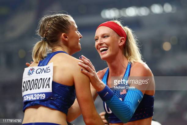 Anzhelika Sidorova of the Authorised Neutral Athletes, gold, and Sandi Morris of the United States, silver, celebrate after the Women's Pole Vault...