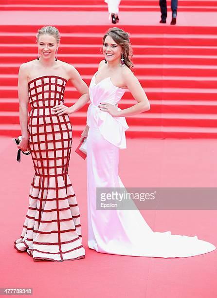 Anzhelika Timaninab and Dariya Tinbush attend the opening ceremony of the Moscow International Film Festival at Pushkinsky Cinema on June 19 2015 in...