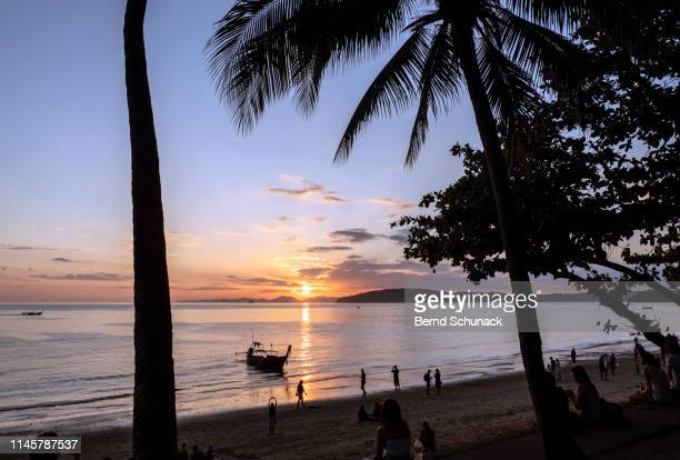 ao nang beach sunset - bernd schunack stock photos and pictures