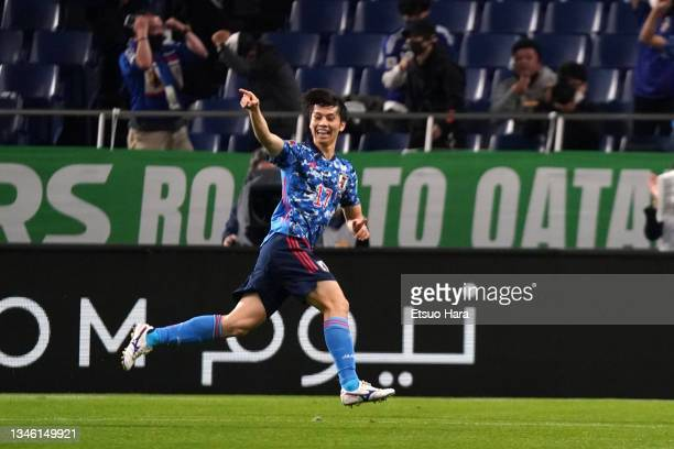 Ao Tanaka of Japan celebrates scoring his side's first goal during the FIFA World Cup Asian qualifier final round Group B match between Japan and...