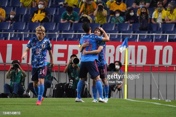 Ao Tanaka of Japan celebrates scoring his side's first goal with his team mate Maya Yoshida during the FIFA World Cup Asian qualifier final round...