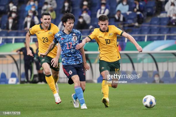 Ao Tanaka of Japan controls the ball under pressure of Ajdin Hrustic of Australia during the FIFA World Cup Asian qualifier final round Group B match...