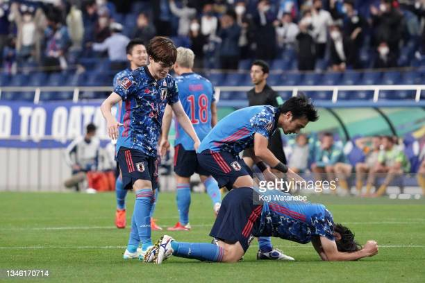 Ao Tanaka of Japan is congratulated by Gaku Shibasaki and Kyogo Furuhashi after his side's 2-1 victory in the FIFA World Cup Asian qualifier final...