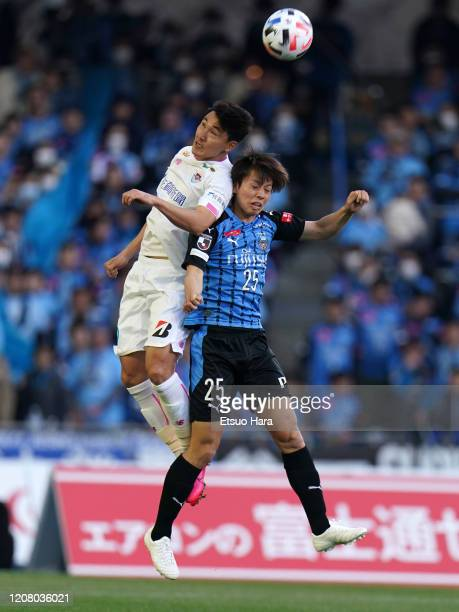 Ao Tanaka of Kawasaki Frontale and Cho Dong Geon of Sagan Tosu compete for the ball during the JLeague MEIJI YASUDA J1 match between Kawasaki...