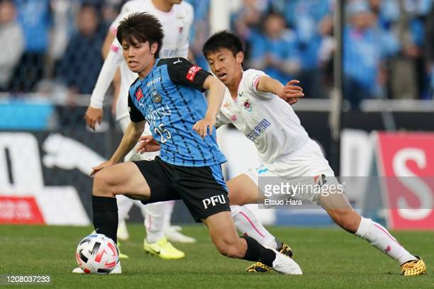 Ao Tanaka of Kawasaki Frontale and Daiki Matsuoka of Sagan Tosu compete for the ball during the JLeague MEIJI YASUDA J1 match between Kawasaki...