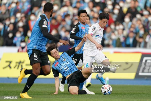 Ao Tanaka of Kawasaki Frontale and Yuto Uchida of Sagan Tosu compete for the ball during the JLeague MEIJI YASUDA J1 match between Kawasaki Frontale...
