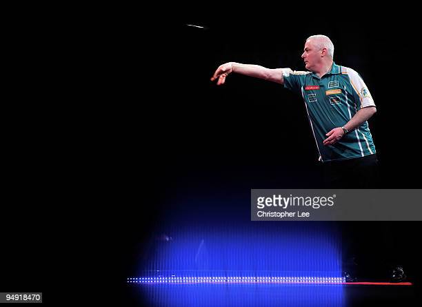 Aodhagan O'Neill of Republic of Ireland in action against Adrian Lewis of England during the 2010 Ladbrokescom World Darts Championship Round One at...