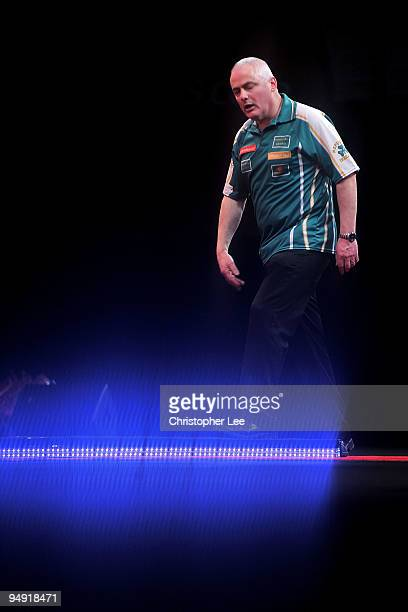 Aodhagan O'Neill of Republic of Ireland looks dejected as he loses against Adrian Lewis of England during the 2010 Ladbrokescom World Darts...