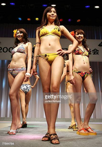 Aoi Nakabeppu the textile company Toray's 2008 swimwear campaign representative poses for photographers displaying one of the season's designs at...