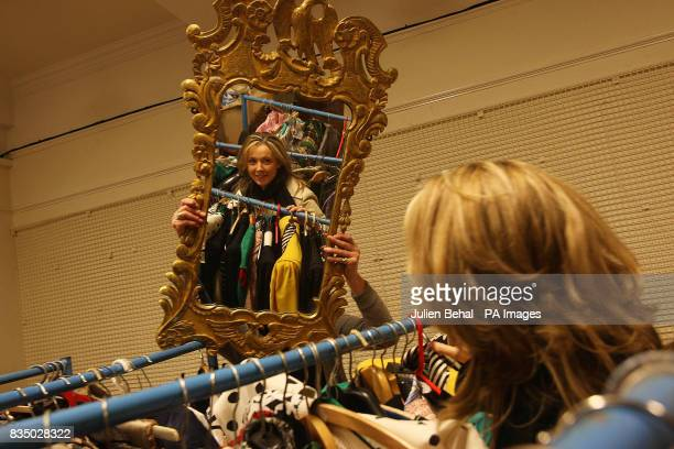Aoife Harrison reflected in a mirror looking at some of the vintage dresses at the Adam's salesroom in Dublin which will sell an exquisite collection...