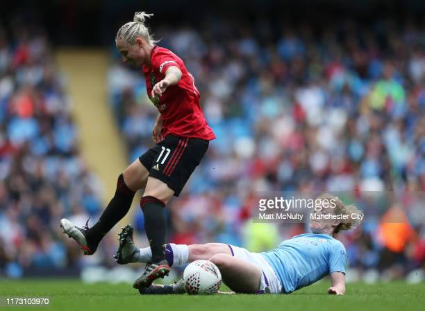 Aoife Mannion of Manchester City tackles Leah Galton of Manchester United during the Barclays FA Women's Super League match between Manchester City...