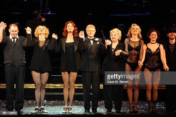 Aoife Mulholland Leigh Zimmerman Jerry Springer and Di Botcher perform on stage during Jerry Springer's first night as 'Billy Flynn' at Cambridge...