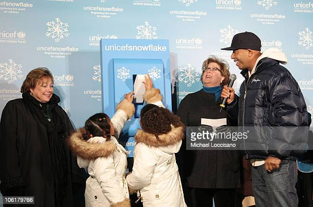 Aoki Lee and Ming Lee light the UNICEF Snowflake as their Father music mogul Russell Simmons and UNICEF Executive Director Ann Veneman and UNICEF...
