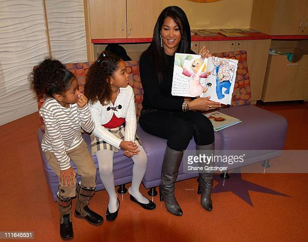 Aoki Lee Ming Lee and Designer Kimora Lee Simmons visit St Vincent's pediatric unit on November 20 2007 in New York City