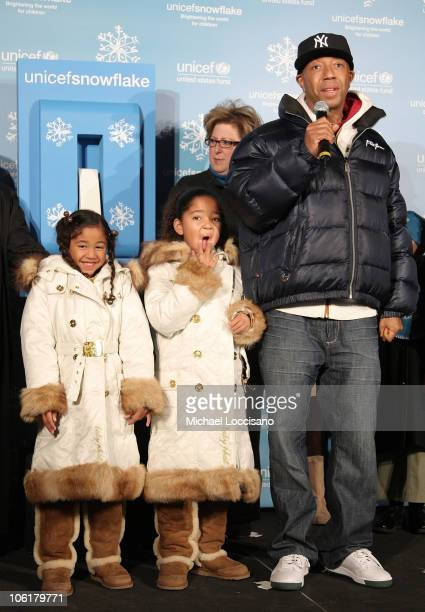 Aoki Lee Ming Lee and UNICEF President and CEO Carol Stern look on while music mogul Russell Simmons addresses the crowd during the UNICEF 2007...