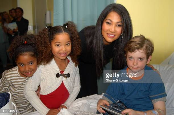 Aoki Lee Ming Lee designer Kimora Lee Simmons and Brian Hennings visit St Vincent's pediatric unit on November 20 2007 in New York City