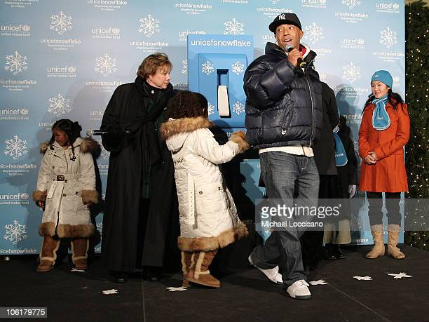Aoki Lee UNICEF Executive Director Ann Veneman Ming Lee and UNICEF/Pier 1 Card Winner Karen Hong look on while music mogul Russell Simmons addresses...