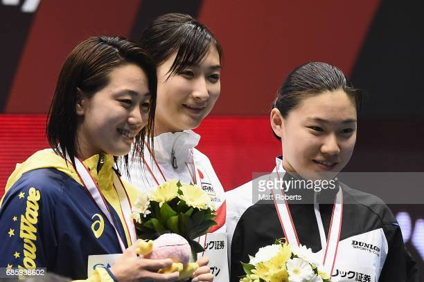 Aoki Tomomi Rikako Ikee and Ouchi Sayuki of Japan pose with their medals on the podium after the 100m Freestyle Final during the Japan Open 2017 at...