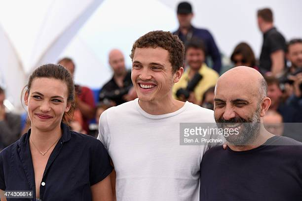 Aomi Muyock Karl Glusman and Gaspar Noe attends the Love photocall during the 68th annual Cannes Film Festival on May 21 2015 in Cannes France