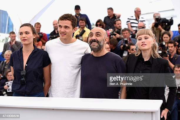 Aomi Muyock Karl Glusman Gaspar Noe and Klara Kirstin and attends the Love photocall during the 68th annual Cannes Film Festival on May 21 2015 in...