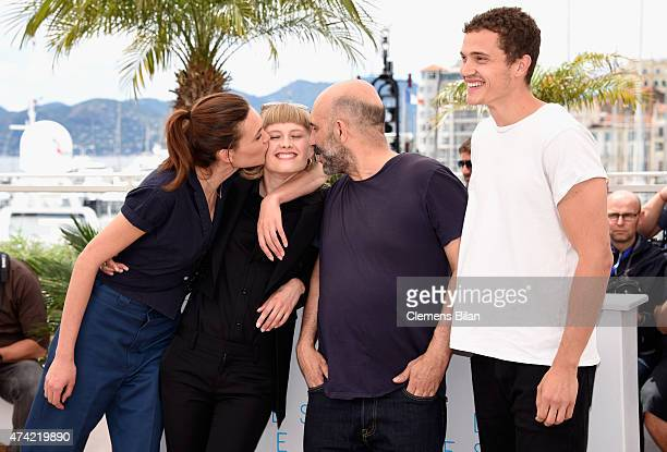 Aomi Muyock Klara Kristin director Gaspar Noe and Karl Glusman attends the Love photocall during the 68th annual Cannes Film Festival on May 21 2015...