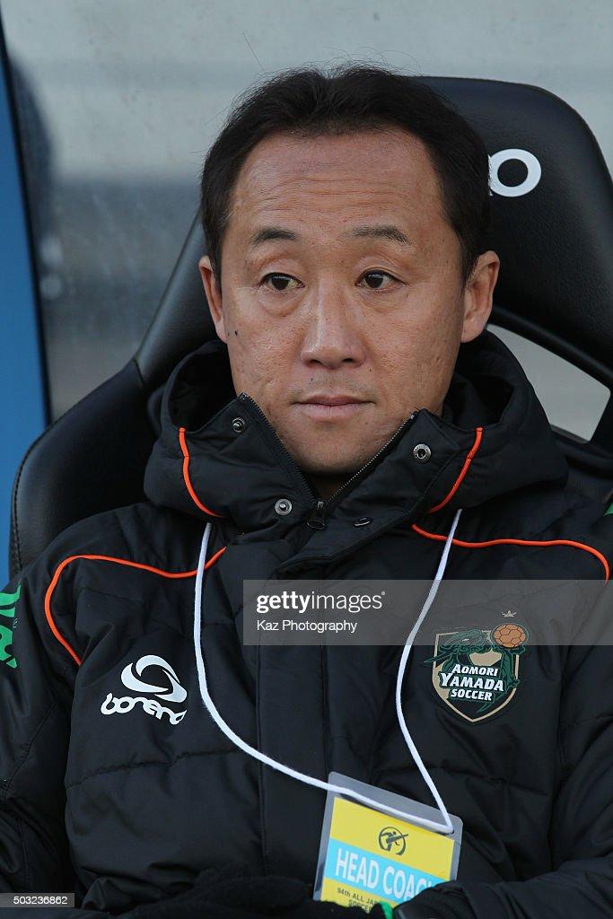 Aomori Yamada head coach Go Kuroda looks on prior to the 94th All Japan High School Soccer Tournament second round match between Aomori Yamada and Seiwa Gakuen at Todoroki Stadium on January 2, 2016 in Kawasaki, Kanagawa, Japan.