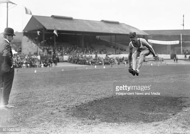 Aonach Tailteann Athletics - Croke Park. Man in long jump. 1928. A.W. Winter winner of the hop, step and jump .
