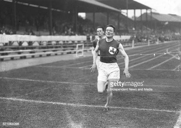 Aonach Tailteann Athletics - Croke Park. Man winning race. 1928. .