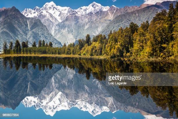 Aoraki reflecting on to Lake Matheson in Westland National Park, New Zealand.