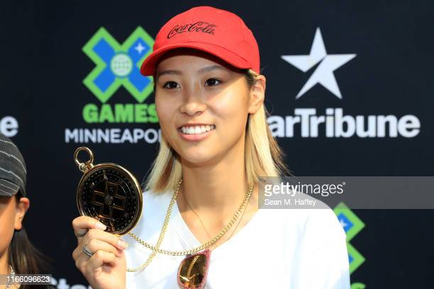 Aori Nishimura of Japan celebrates first place on the podium for the Women's Skateboard Street at the X Games Minneapolis 2019 at US Bank Stadium on...