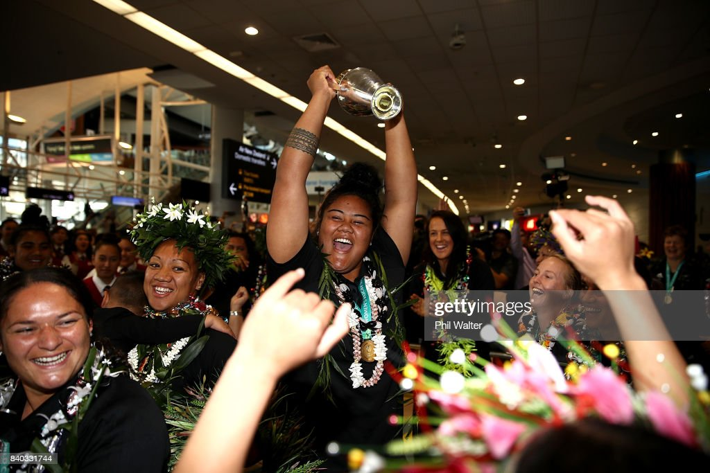 Aotearoa Mata'u of the Black Ferns dances with the trophy as the New Zealand Black Ferns arrive at Auckland International Airport on August 29, 2017 in Auckland, New Zealand. New Zealand won the 2017 Women's Rugby World Cup by defeating England in the Final in Belfast.