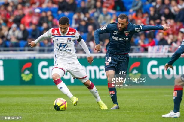 Aouar Houssem of Lyon and Marie Jordan of Dijon during the Ligue 1 match between Lyon and Dijon at Groupama Stadium on April 6 2019 in Lyon France