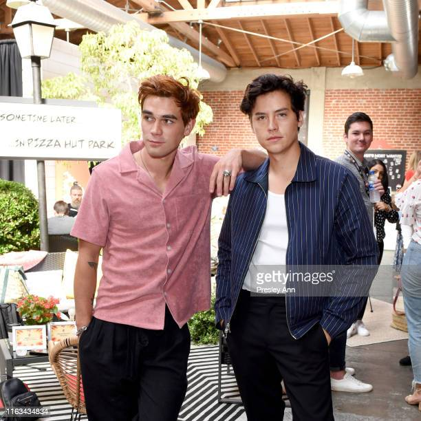 KJ Apa and Cole Sprouse of 'Riverdale' attend the Pizza Hut Lounge at 2019 ComicCon International San Diego on July 20 2019 in San Diego California