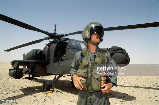 Apache attack helicopter pilot Gus Grissom in the Saudi desert before the allied intervention in Kuwait during the Persian Gulf War, December 1990....