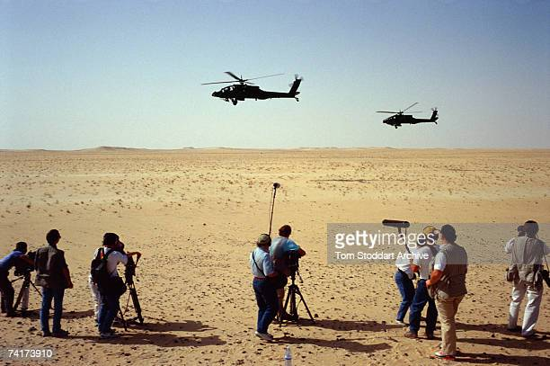 US Apache attack helicopters carrying Hellfire missiles being filmed by the media over the Saudi desert before the allied intervention in Kuwait...